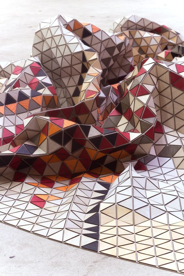 Elisa Strozyk, flexible textiles craft: colourful geometric rug made using wooden triangles #design #wow