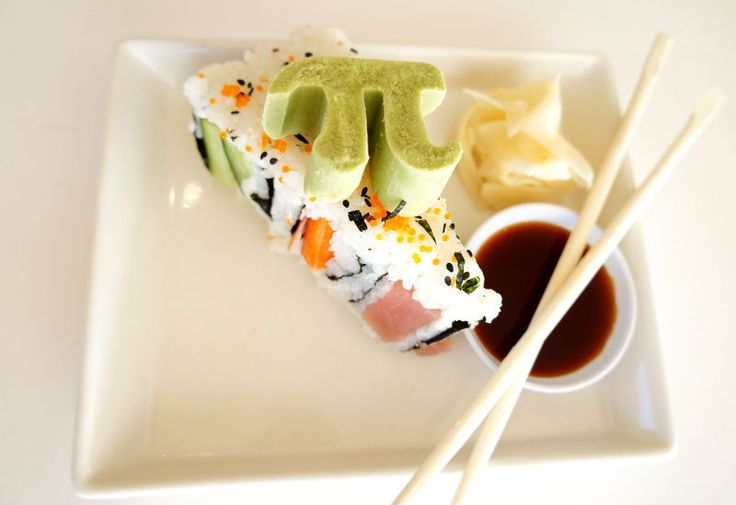 What do you serve a group of mathematicians on International Pi Day? Serve them this sushi in the round, where Pi and Pie make there appearancein many different ways, from the molded Pi wasabi to the circumference of the pie.