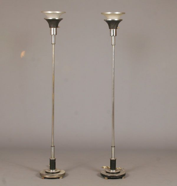 Pair Art Deco polished metal torchiere lamps;