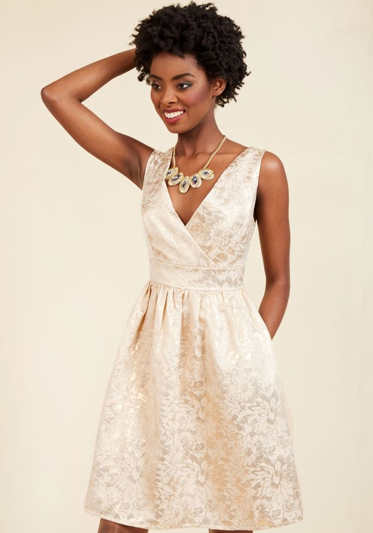 Display of Luxe A-Line Dress | Mod Retro Vintage Dresses | ModCloth.com  Looking for an oh-so-fancy frock for a special occasion? We say indulge in this ivory dress! Its charms include a surplice neckline, princess seams, and - everyone's favorite - hidden pockets. This gold-embroidered floral stunner gives you such a rich look, you may be tempted to treat yourself all night long.