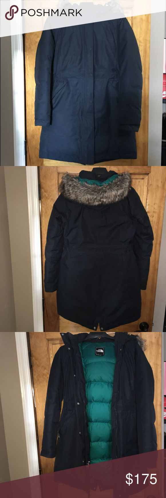 North Face Arctic Parka (M) The North Face women's Arctic Parka in the color Navy with a pretty teal green interior. Size medium. In great condition, was worn gently for only 2 seasons. Hood and faux fur is removable. Such a warm and cozy parka, you will never be cold with this jacket. The North Face Jackets & Coats Puffers