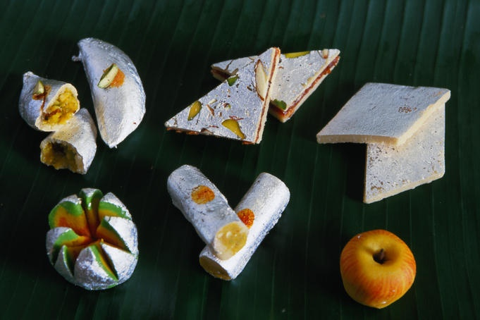 ) barfi. Yellow colouring is from saffron, nuts are are pistachio ...
