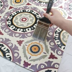 Make your own custom rug out of any fabric you love from the craft store!