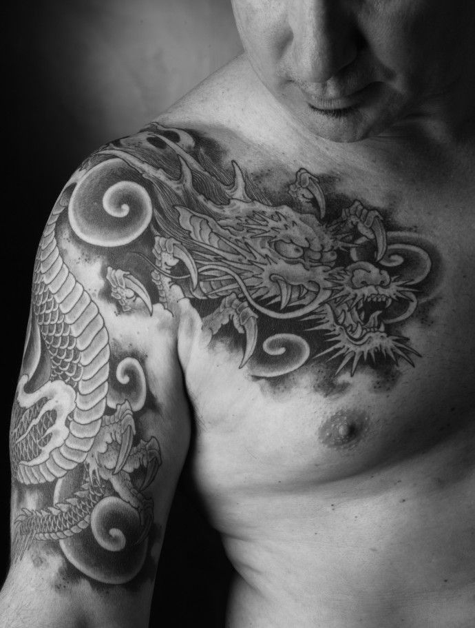 A Chris Garver dragon tattoo. It was a dragon like this that inspired my first tattoo.