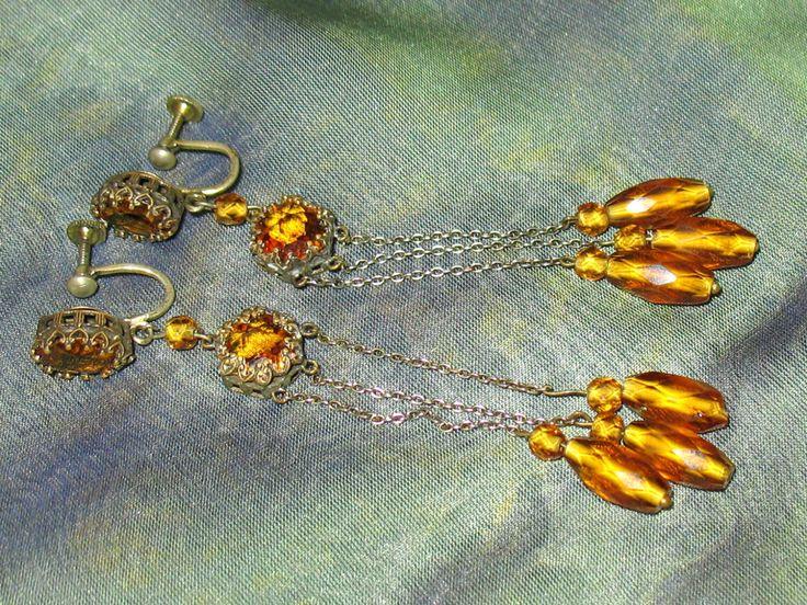 1920s Earrings, Deco Faceted Glass Czech Earrings, 30s Art Nouveau Screw Back Dark Yellow Glass Czech Screw Back Earrings, Antique Earrings by SpiderVintage on Etsy https://www.etsy.com/listing/205999226/1920s-earrings-deco-faceted-glass-czech