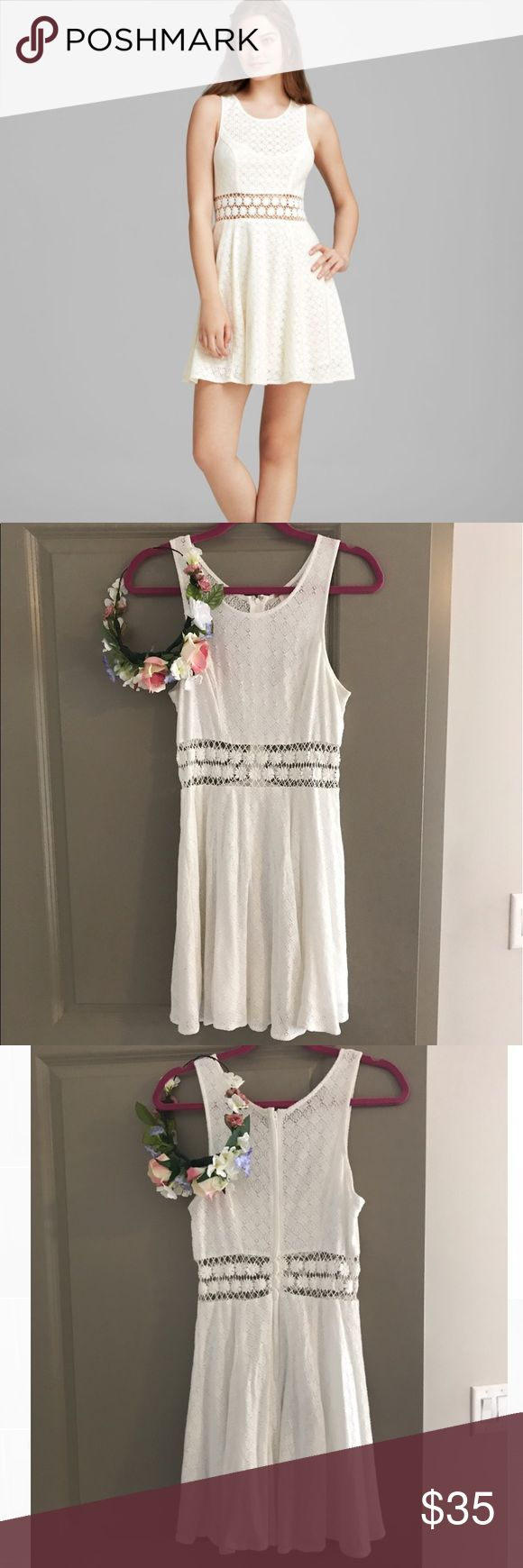 Free People White Dress with Cutouts Super cute Free People white dress with flower cutouts! Size 6. Great for the summer! Free People Dresses