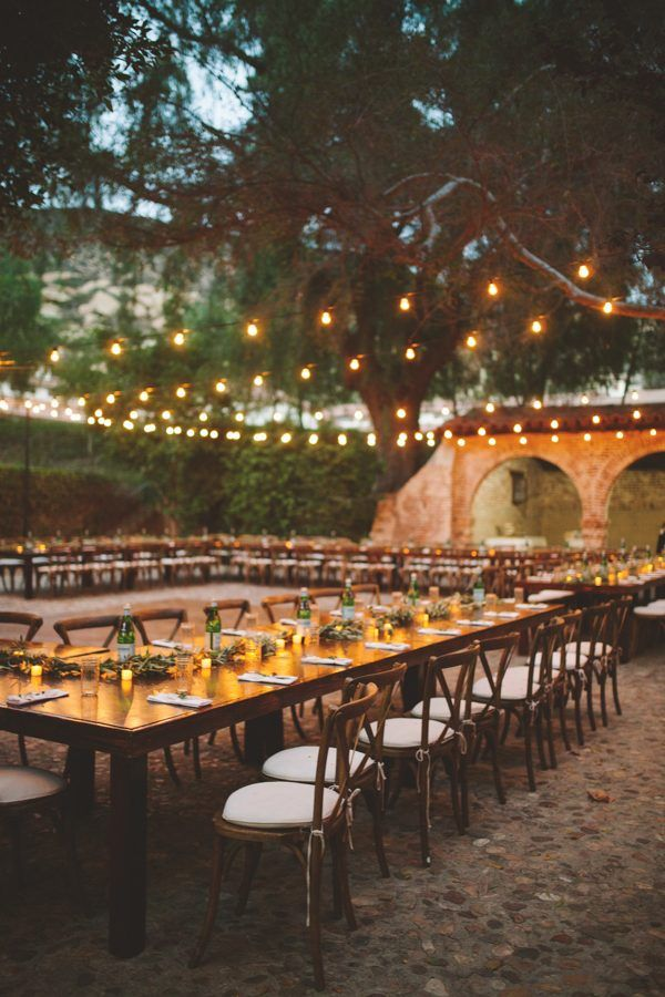 Long wood farm tables, eucalyptus, and string lights set the mood for this summer soiree | Image by The Shalom Imaginative