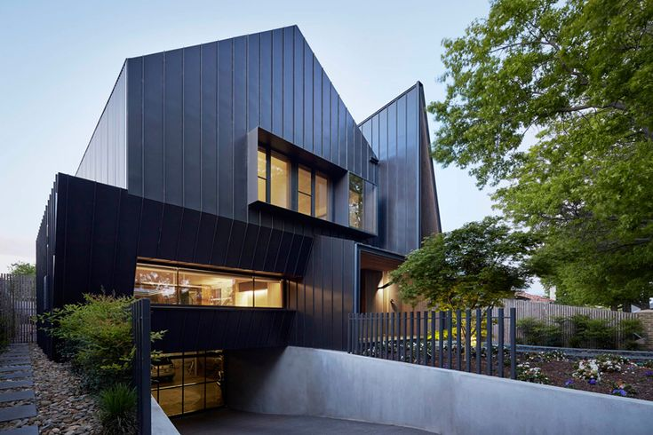 Inarc Architects have designed a black zinc clad home for a couple in Ballarat, Australia.