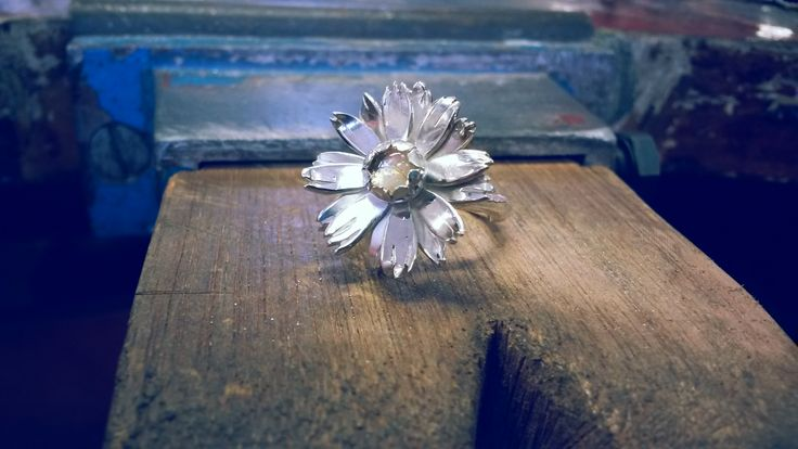 daisy ring with a citrine setting in the middle