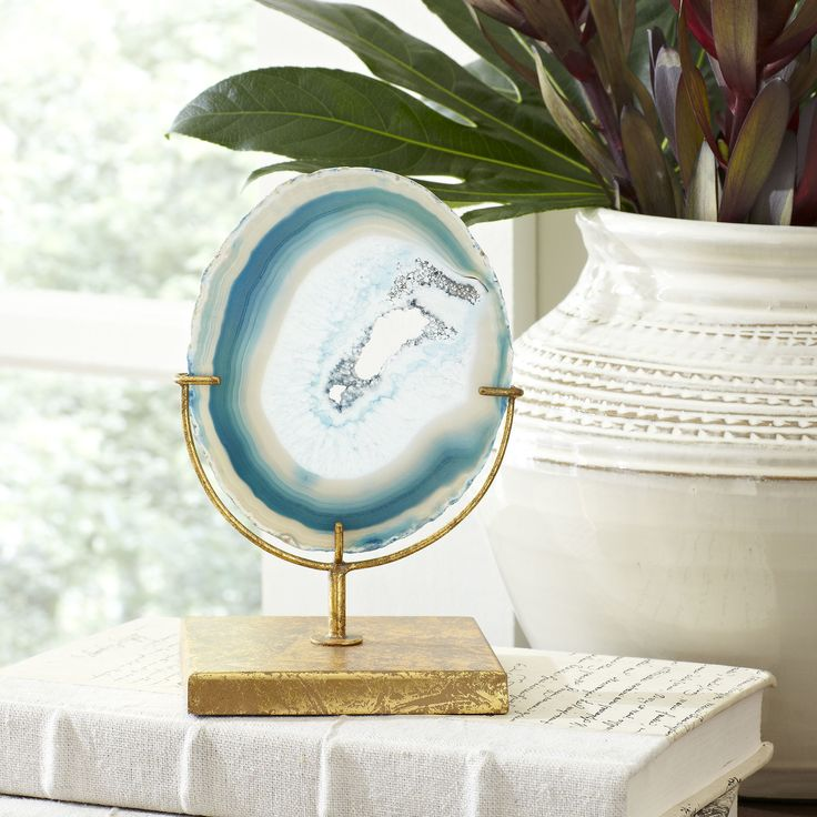 Blue Agate Decor | Gorgeous slices of blue agate are mounted on aged, golden stands to offer an accent that pulls in natural beauty to enhance your space. Each piece is made with its own unique slice of mineral, so looks may vary.