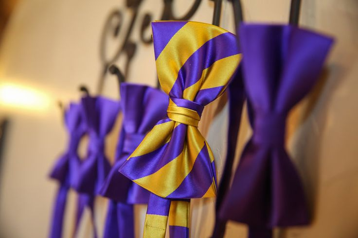 Purple and yellow bow tie for the groom, simple purple for the groomsmen!