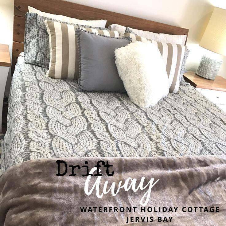 Beach house bedroom idea. Bed made by Wildwood Designs. Grey and Beige and white colour scheme