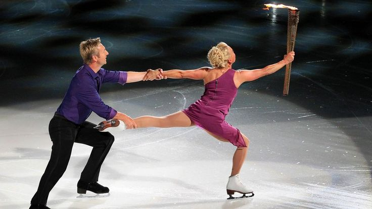 Christopher Dean and Jayne Torvill dance on ice with the flame