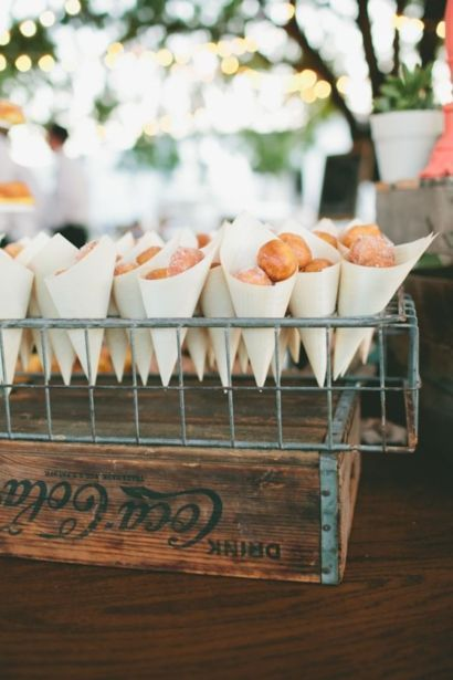 doughnut holes served inside cones and displayed inside an upside down wire crate