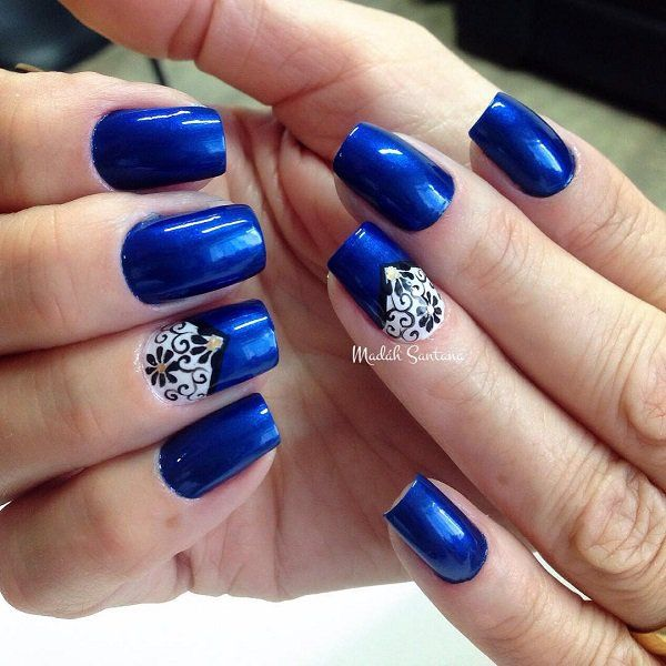 Fashionable and elegant looking blue themed nail art design. This design also uses white and black polishes for the details inwards the nails.
