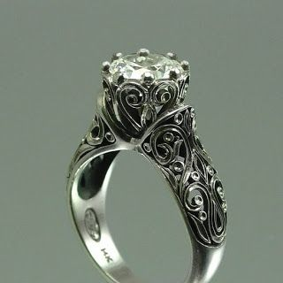 Likes: Metal scrollwork, vintage look  Dislikes: General rounded look of band/ring