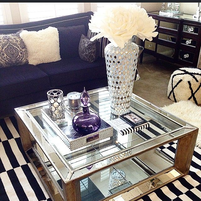What a chic coffee table display by @happy_decormilly_ featuring our Pascual Coffee Table, Everglades Rectangular Tray, Sultan Canister, Fez Vase, and Large Mums.