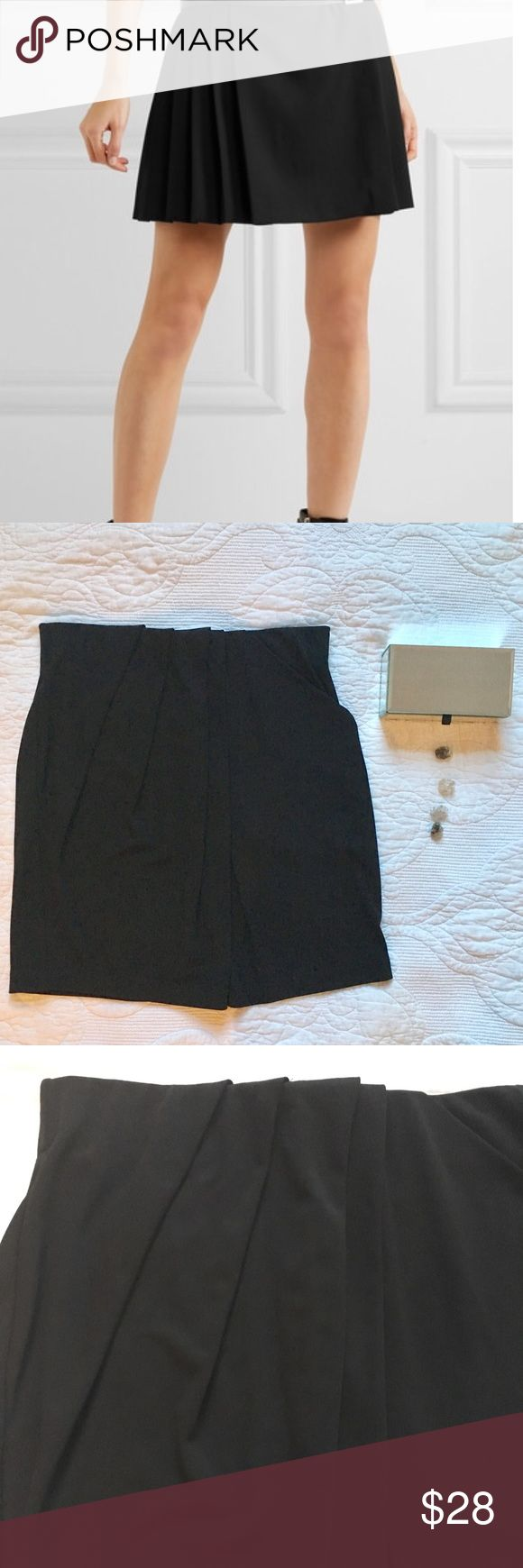 BCBGMaxAzriaPleated Faux Wrap Mini Skirt XXS Adorable little mini skirt with Pleated detail and faux wrap look. Side slit pocket!! Slinky stretchy synthetic material. Elastic waist. Size xxs.  Pls see photos for approx measurements but pls keep in mind quite stretchy. First photo is stock and for style reference only. Back is not pleated. BCBGMaxAzria Skirts Mini