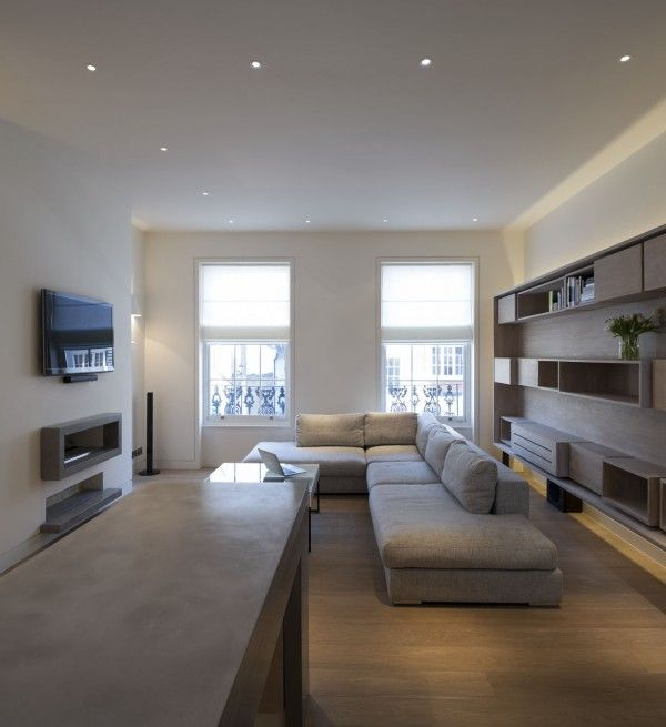 Polished concrete worktop, fireplace surround and shelf in the butterfly loft apartment by tigg coll architects.