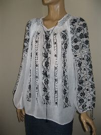 Hand embroidered and hand sewn Romanian peasant blouse , embroidered with black cotton thread . Available at www,greatblouses.com