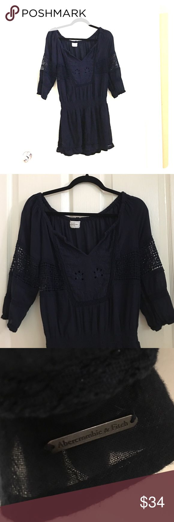 Abercrombie and Fitch Dress Abercrombie and Fitch Dress. Navy blue. Long Sleeve with eyelet hole design on the top. Gathered at the waist. Size S Abercrombie & Fitch Dresses Long Sleeve