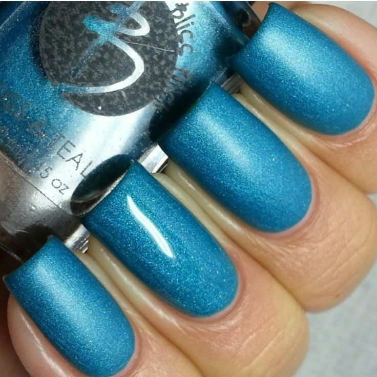 Teal shimmer with holo glitter flecks. Applies matte but will appear glossy when a top coat is applied.  Photo credit Gaby @lacquerloon on Instagram  Ingredients: Butyl Acetate, Ethyl Acetate, Nitrocellulose, Adipic Acid / Neopentyl Glycol/ Trimellitic Anhydride Copolymer, Acetyl Tributyl C...