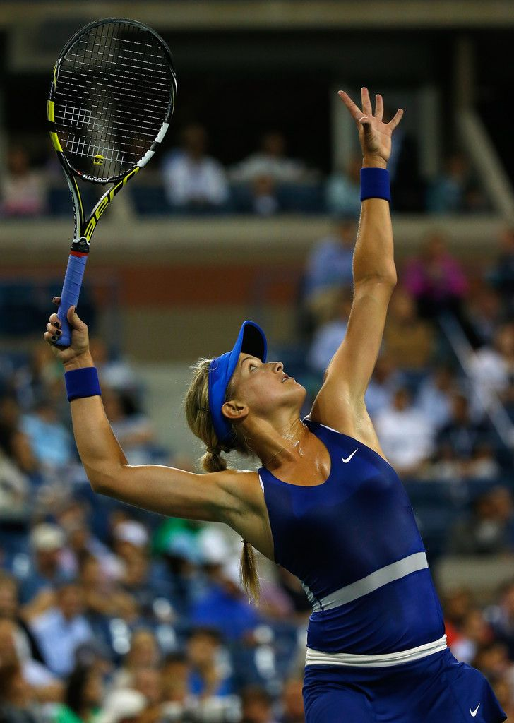 Eugenie Bouchard Photos: US Open: Day 4. Eugenie Bouchard of Canada serves against Sorana Cirstea of Romania on Day Four of the 2014 US Open at the USTA Billie Jean King National Tennis Center on August 28, 2014 in the Flushing neighborhood of the Queens borough of New York City.