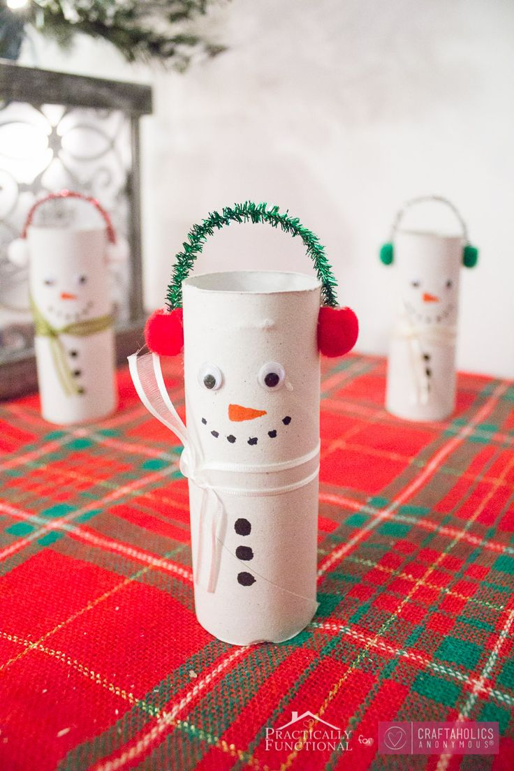 Recycle your toilet paper rolls into cute snowmen with this easy winter craft idea! DIY Toilet Paper Roll Snowmen is a great winter craft for kids.