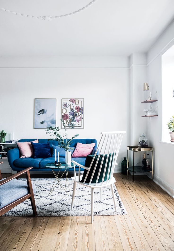 Scandinavian living room with blue sofa