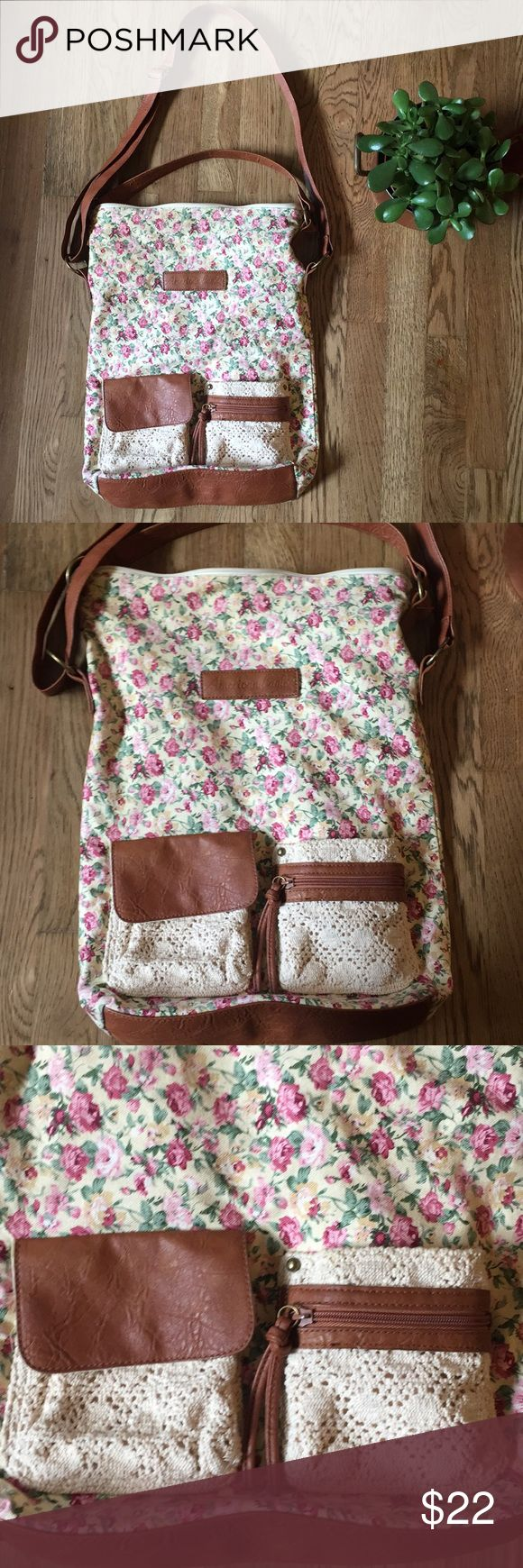 AE crossbody tote bag In great condition bag. Cute floral pattern. Some pen marks on the inside of the bag and one on the back. See pictures. Hardly noticeable. American Eagle Outfitters Bags Crossbody Bags
