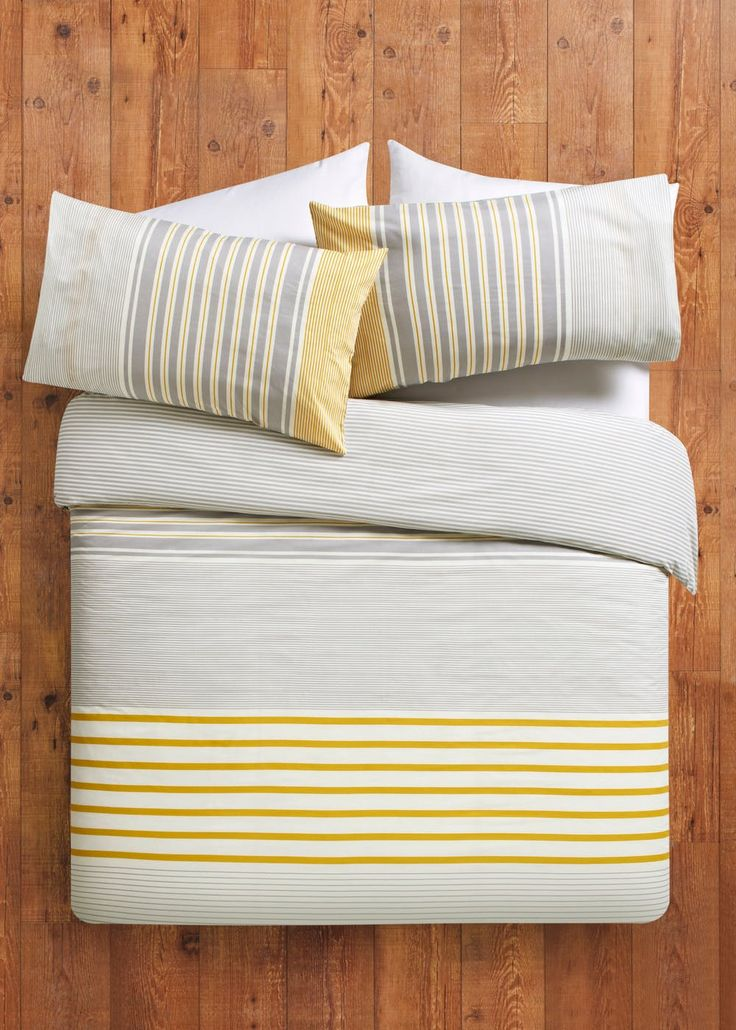 Brighten up your bedroom with this simple yet sophisticated varied stripe printed duvet cover in grey and yellow. The single set contains one pillowcase and...