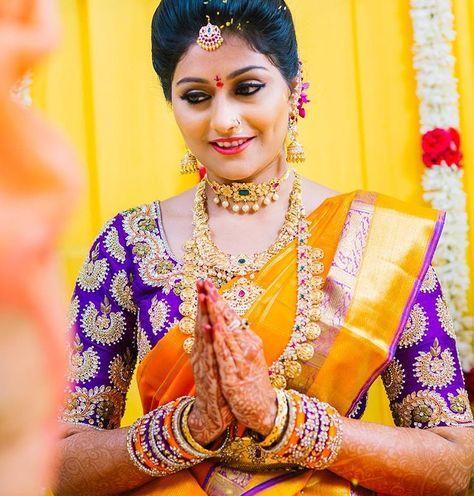 South Indian bride. Gold Indian bridal jewelry.Temple jewelry. Jhumkis. Mustard yellow silk kanchipuram sari with contrast purple blouse.Braid with fresh jasmine flowers. Tamil bride. Telugu bride. Kannada bride. Hindu bride. Malayalee bride.Kerala bride.South Indian wedding.