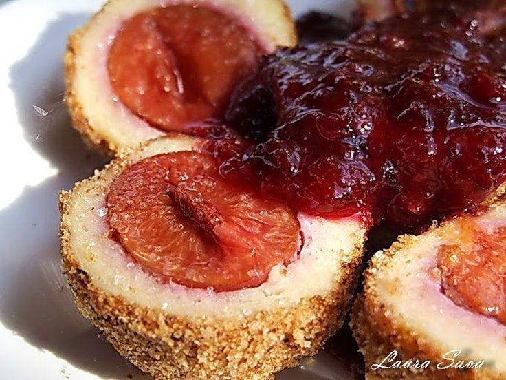 Galustele cu prune, sau gombotii, sint pentru noi (pentru mine, mai ales, ca eu chiar sint lesinata dupa ele!!!) atractia zilei, a serii...a verii, a toamnei... :P Sint delicioase si parca nu...