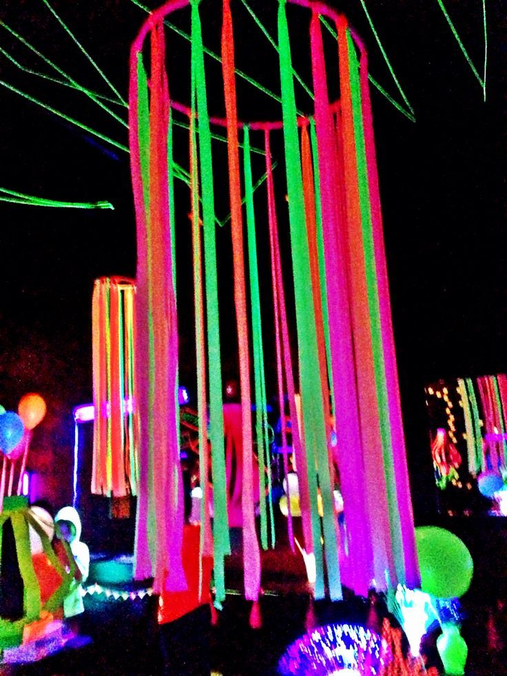Neon flagging tape on hulla hoop, glow party decoration Fnid more festival, rave and EDM stuff at https://www.festguru.com/