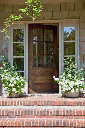 Classic Wood Door + brick steps. Love this exterior!
