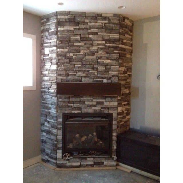 #Fireplace with Ready Stack (Color: Glacier) in a Duncan McGregor house in #Lethbridge AB. Installed by RR Masonry www.KodiakMountain.com #kodiakmountainstone #mason #customhome #interiordesign #rockwork #stonefireplace