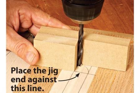 Instead of wrestling with large boards on a small drill-press table, use this simple bit-alignment jig.