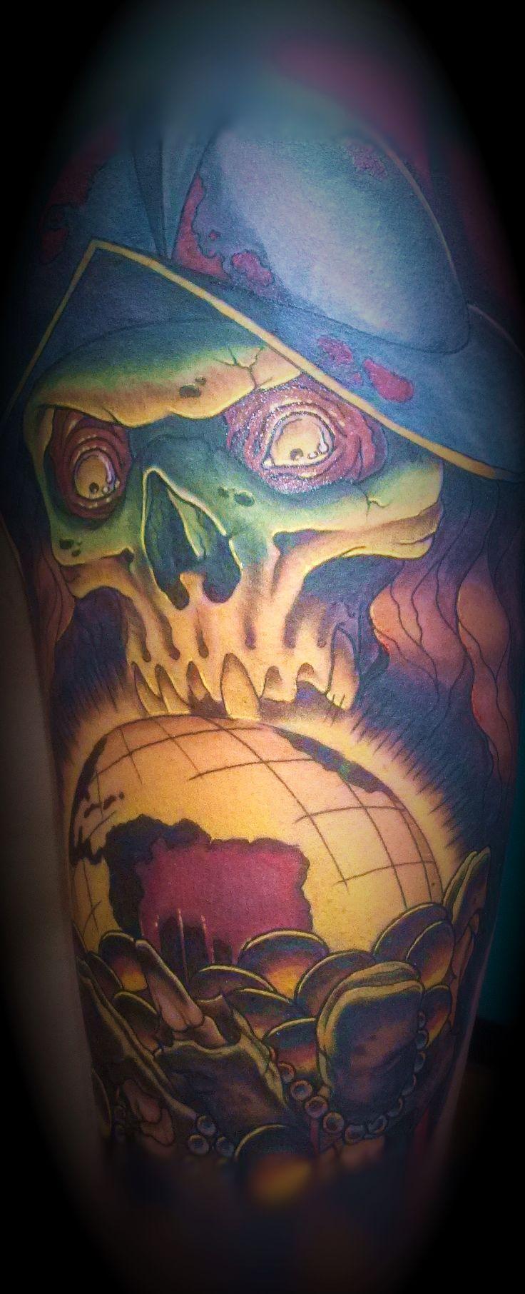 Done by tattoo artist Scott Mundy
