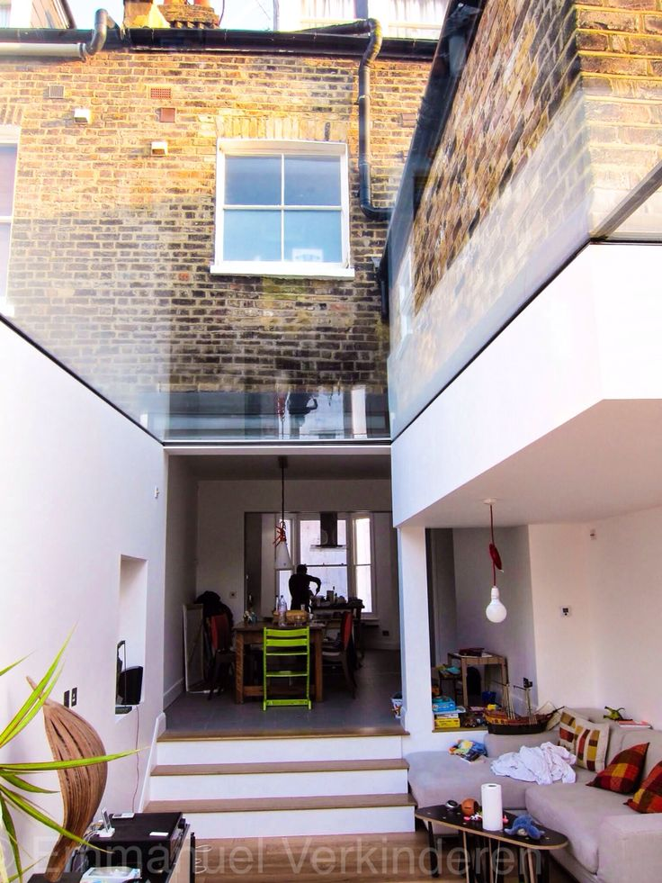 Victorian house extension. Largest glass panel available in UK used to form the roof. Design Emmanuel Verkinderen