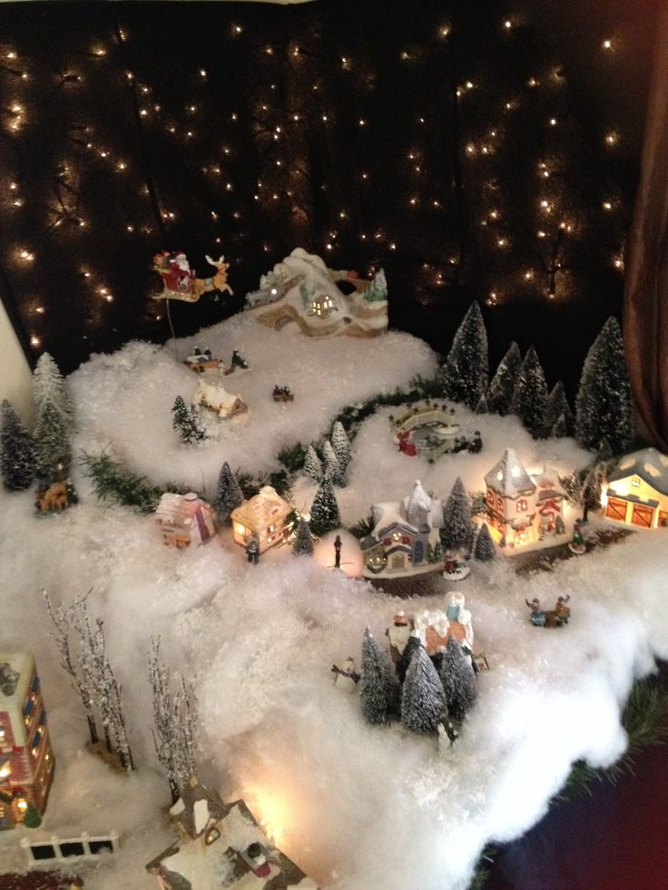 Christmas Village.  Love the icicle lights for a starry starry Christmas night.