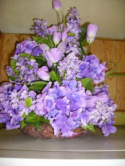 Lavender and lilac and purple silk flower arrangement:
