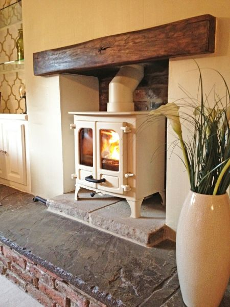 Charnwood Island 1, oak fireplace beam, brick rear wall and reclaimed Yorkshire stone hearth.