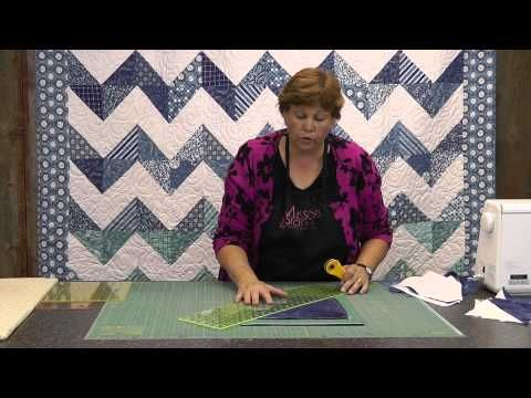 "How to make a Chevron Quilt using 10"" Fabric Squares. for Gastlie Grim fabric...I have seen this done with black fringe pom poms in between the stripes"