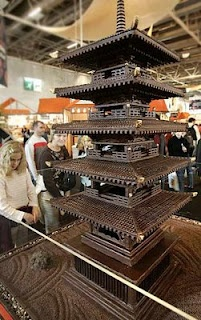 Chocolate Pagoda - Visitors look at a chocolate pagoda during the Chocolate Show which gathers chocolate makers from all over the world in Paris, 2004.