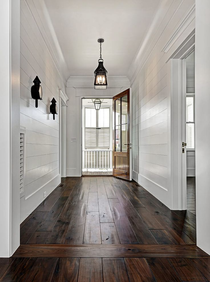 White And Dark Wood Entry With Shiplap Walls Wood Floor