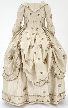 Robe à la Polonaise (back view), English, ca.1780 silk, cream brocaded silk woven with clusters of flowers in pinks and greens.worn by Mary Mcdowell, daughter of William Mcdowall of Castle Semple.The large size of the closed bodice suggests that it may have been worn while Mary was pregnant. This is supported by the diaries of Mrs Jean Houston, Mary's mother-in-law. © CSG CIC