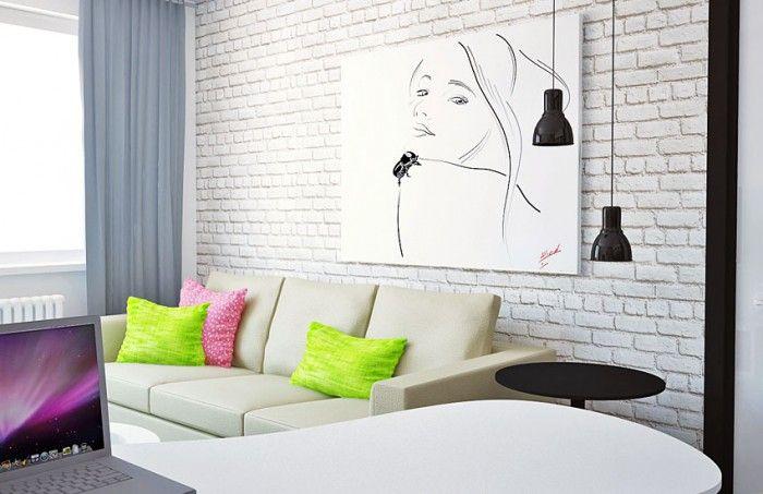 - Акцентная кирпичная стена украшена картиной с очень женственным, изящным рисунком; - Яркие подушки на диване - необходимые цветовые пятна: - Нейтральные шторы, не отвлекающие внимания.