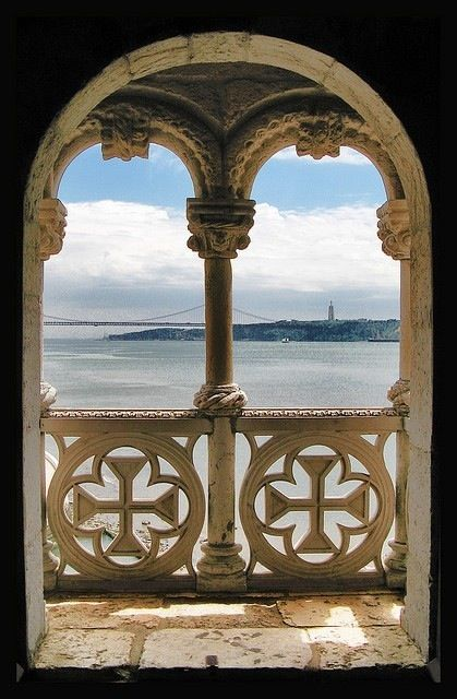 One of my favourites!! It's a beautiful window in the Torre de Belem in Lisbon, looking over the Tagus River, with April 25th Bridge and the Christ  sculpture, both on the far end. The Belem Tower is a mark of the Portuguese Discoveries, and a beautiful place to visit!