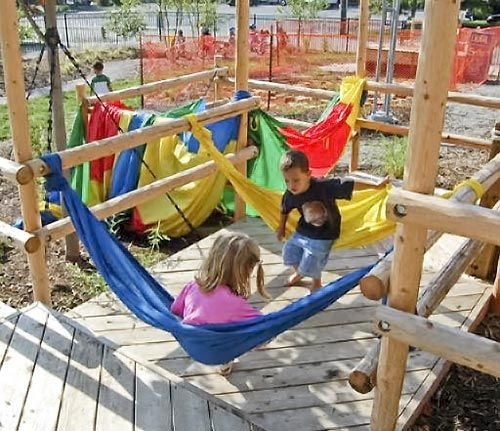 Fabric Swings. I would definitely have a mat underneath for my girl though.