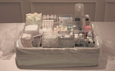 Now THAT'S a fancy wedding bathroom basket (good list in the accompanying link, but I don't think mine will look this good)